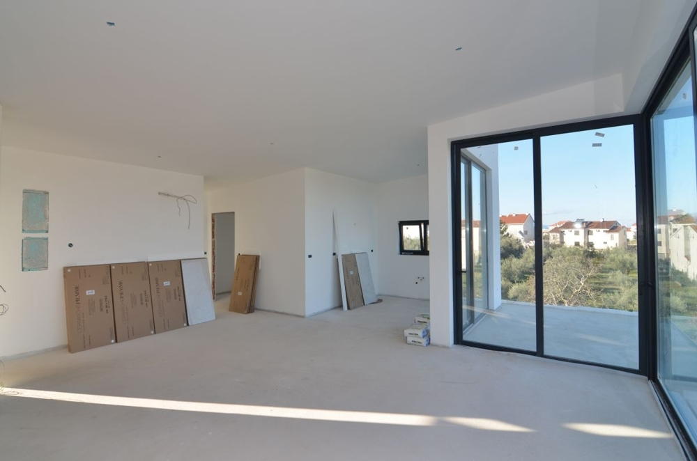 Open plan living area of ​​apartment A1164 for sale on the island of Krk in Croatia.