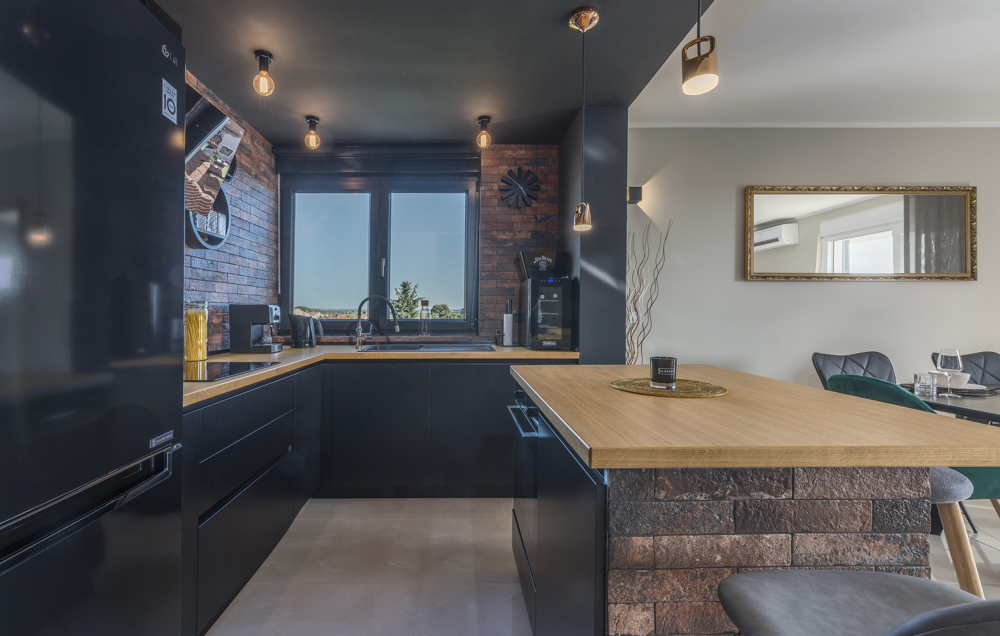 Modern kitchenette with cooking block and window of property A1167.