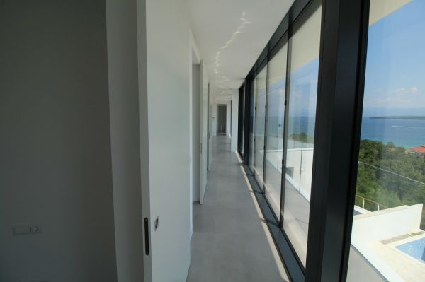 Glass fronts at the penthouse with sea views for sale in Croatia, island Krk
