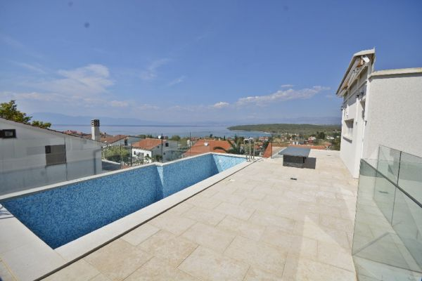 Modern apartment with swimming pool in Njivice on the island of Krk for sale.