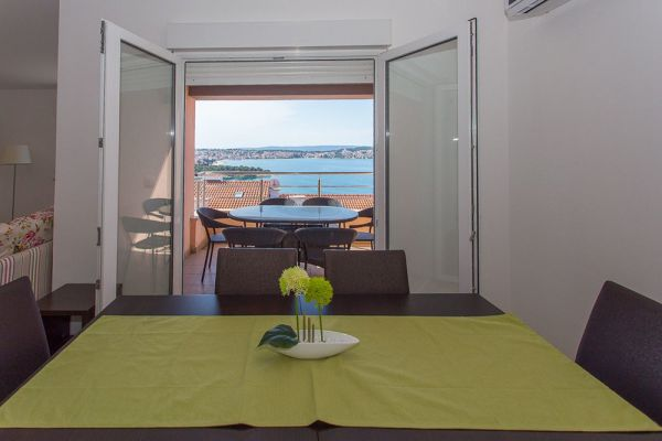 The view from the living-dining area to the balcony of the apartment for sale in Trogir, Croatia. Realtor Croatia - Panorama Scouting