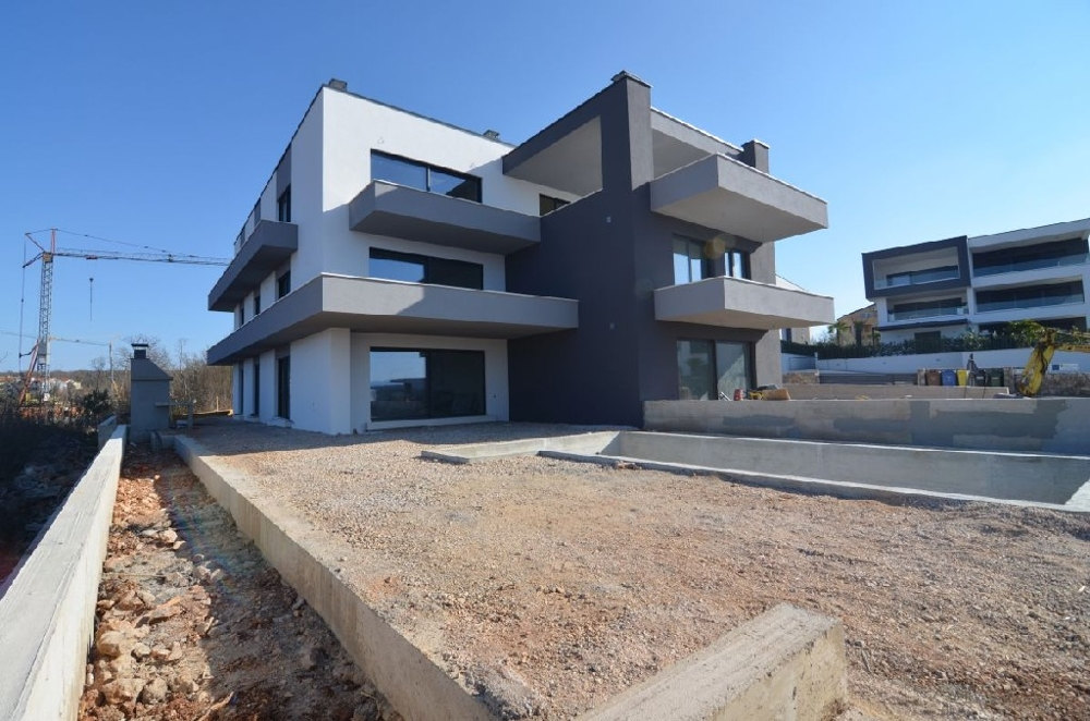 The apartment A1300 is located in a modern new building in Malinska, Croatia.