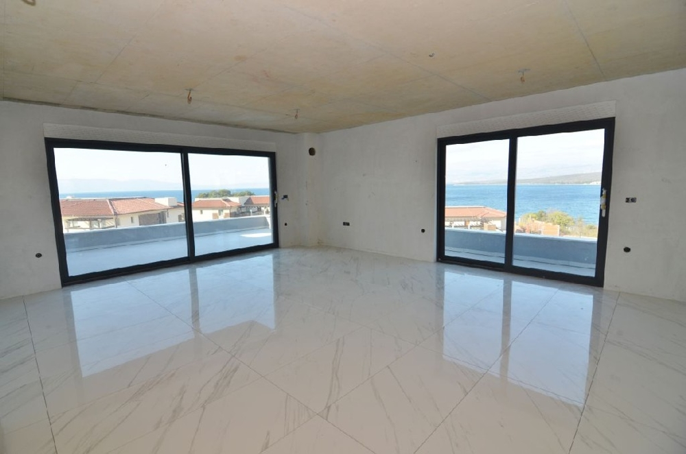 Spacious living room with access to the large terrace with stunning views of the blue sea.