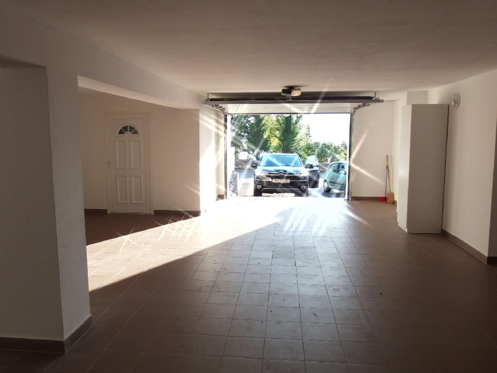 A parking space in the garage is included in the purchase price.