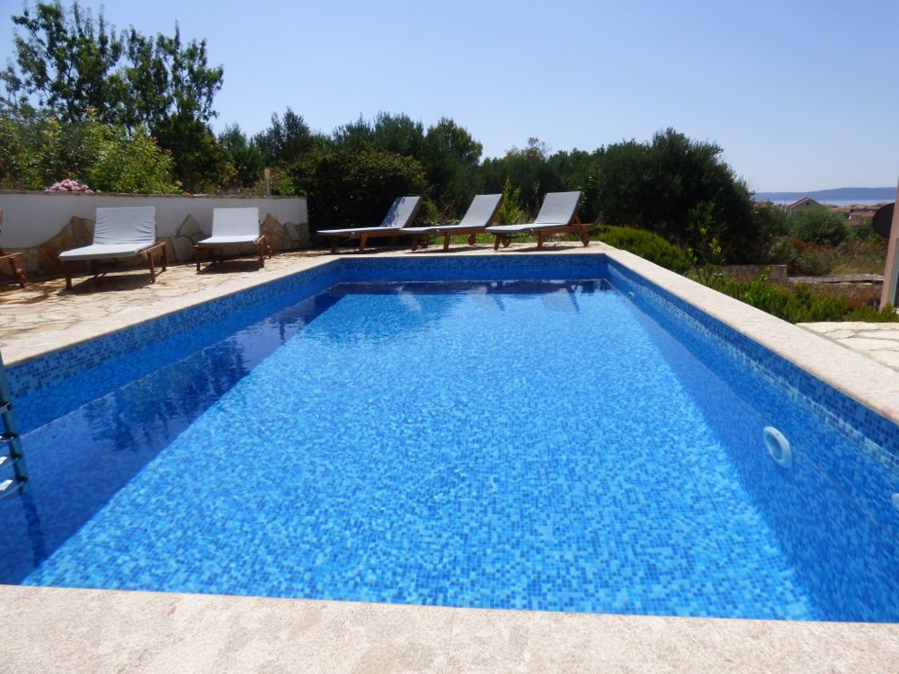 Swimming pool of the apartment A1326 which is for sale in Dalmatia on the island Ciovo.