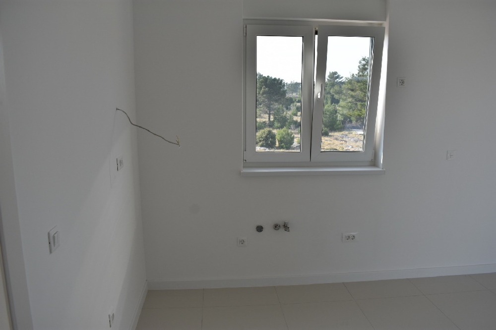 Bedroom of new apartment A1528 in Croatia.
