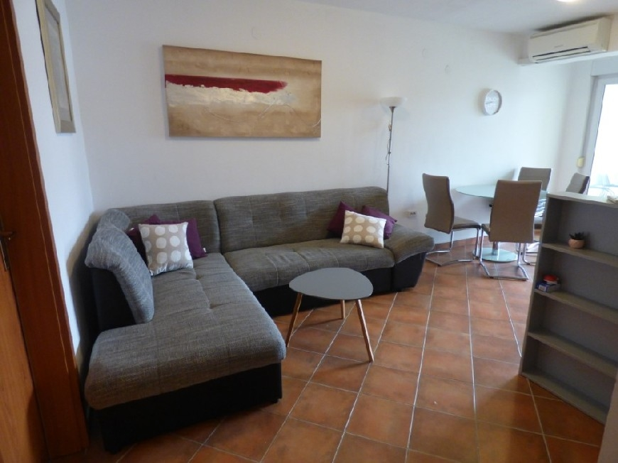 Furnished living room with comfortable furniture in apartment A1540.