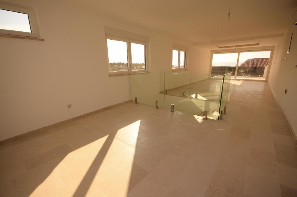 The living room and the staircase on the second floor of property A1544 on Krk in Croatia.