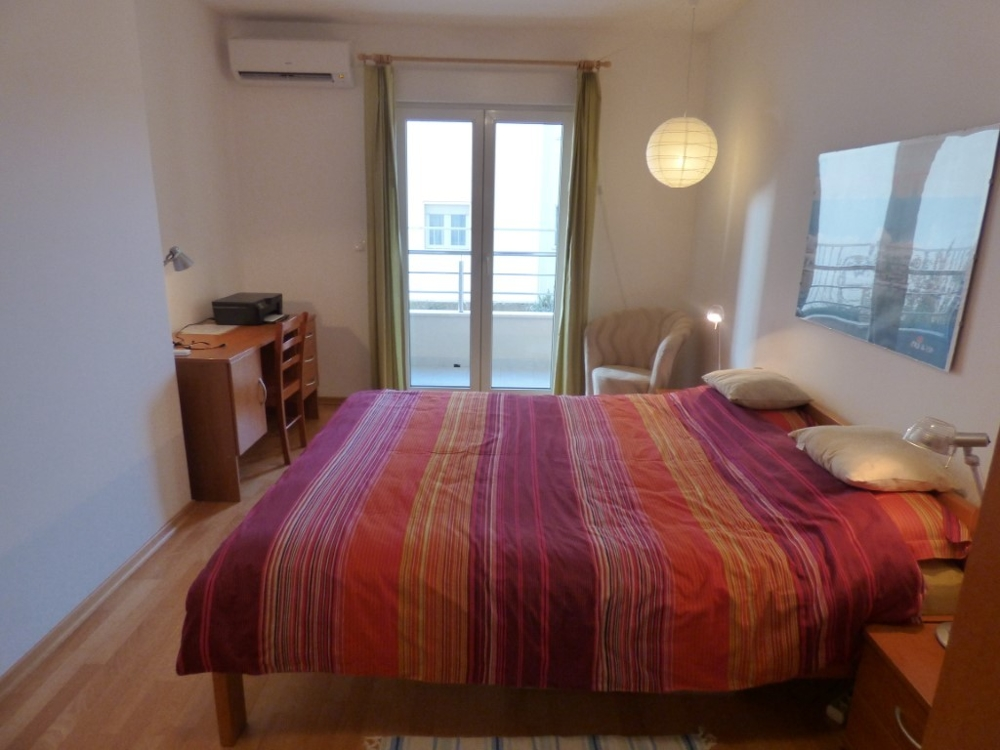 Bedroom with balcony - property A1549 in Croatia, island of Ciovo.