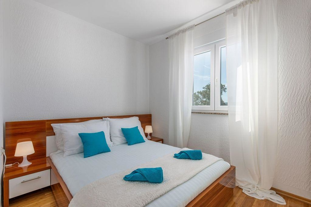 The bedroom of property A1562 in the Crikvenica region, Croatia.