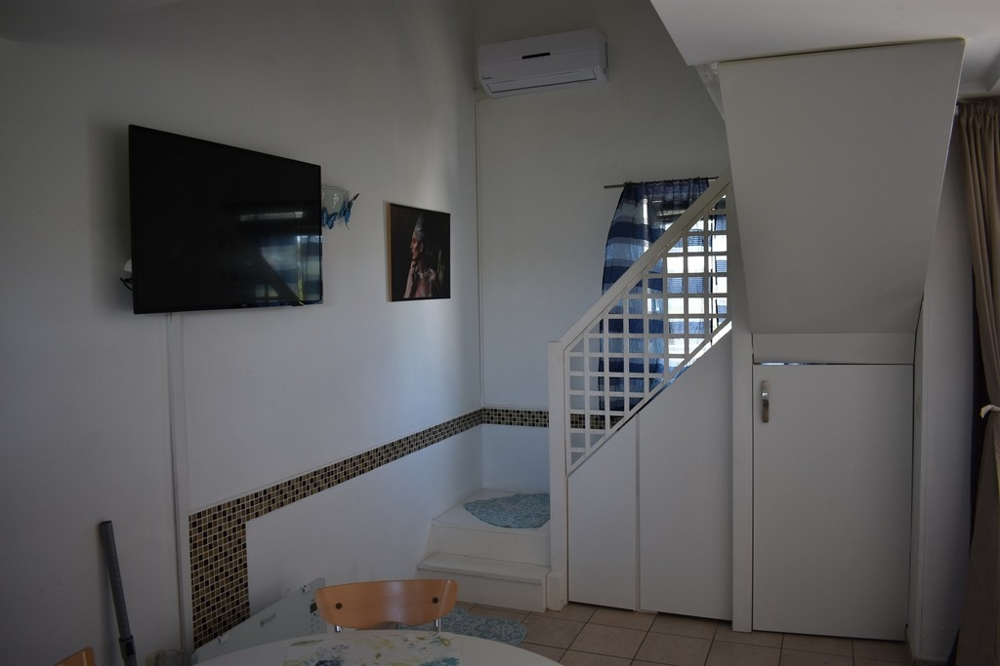 Internal stairs lead to the upper floor of apartment A1629, Zadar region.
