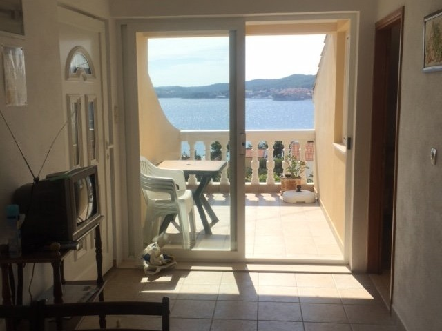 View from the dining area onto the balcony and the sea on the Peljesac peninsula - panorama scouting.