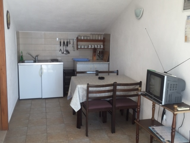 View of the dining area and kitchen of property A1658 in Croatia.