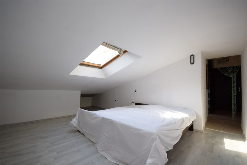 The large bedroom of apartment A1732 in Croatia.