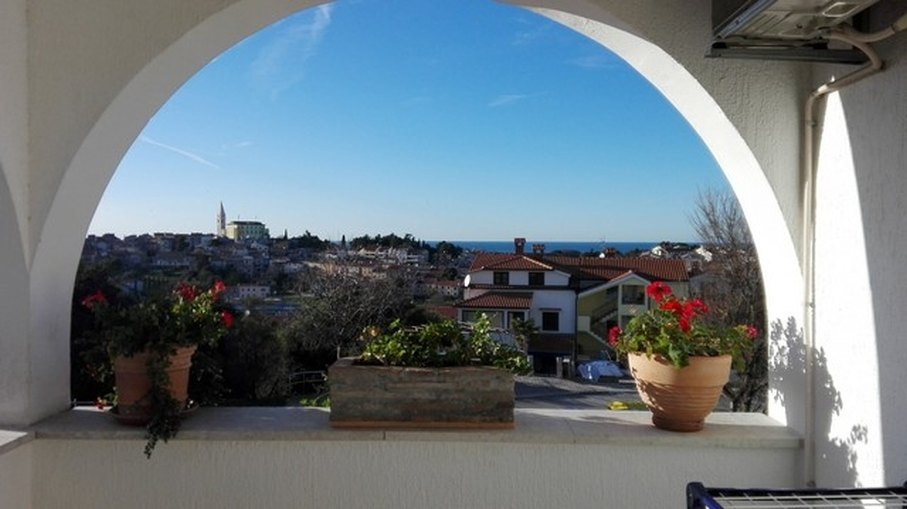 View of the old town of Vrsar from the balcony of the apartment A854, for sale near Vrsar.