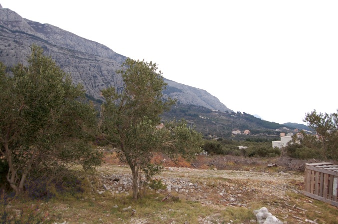 The view of the steep slopes of Biokovo from the plot with sea views for sale in Dalmatia
