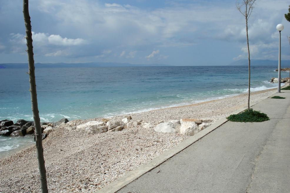 The small access road of the building plot directly on the sea in Croatia in the first row to the sea