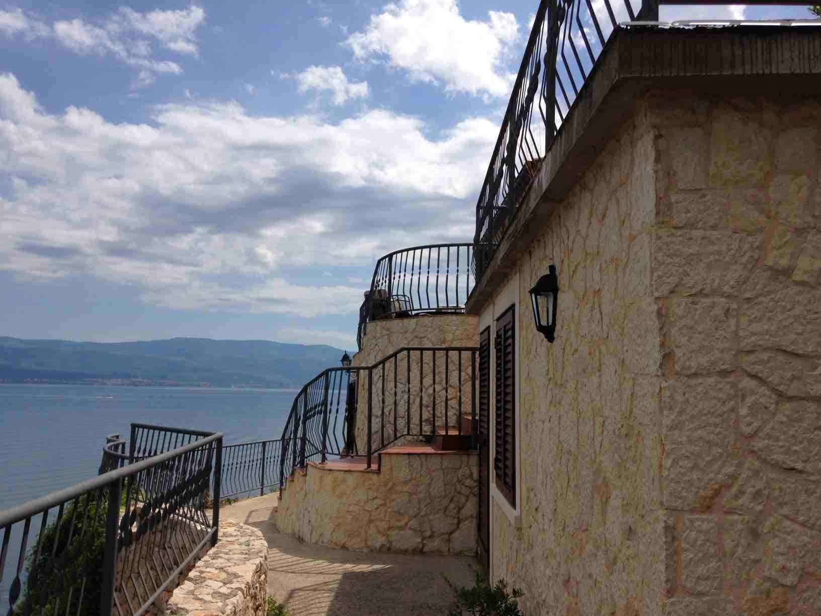 Here is a picture of the house on the rock cliffs for sale with panoramic views of the island of Krk, Croatia