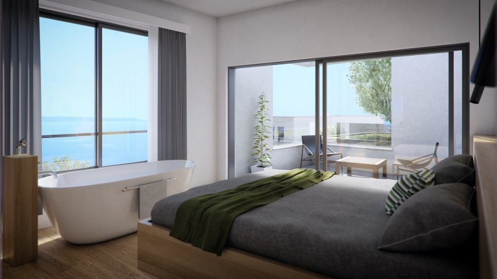 Another bedroom with ensuite bathroom and great views across the sea.