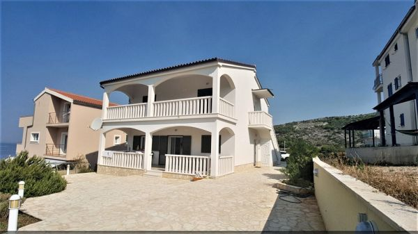 Buy house with two apartments in Croatia.