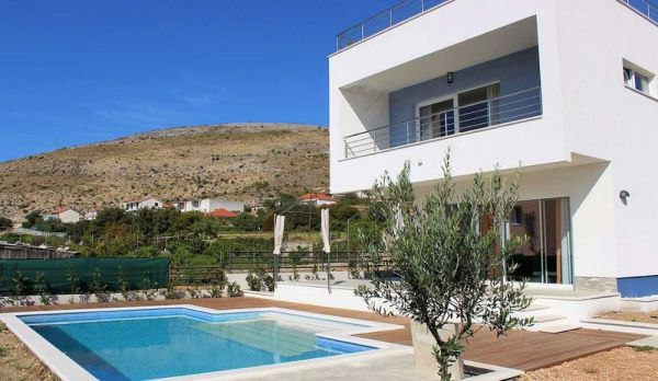 The villa with pool and roof terrace is for sale near Trogir, Croatia.