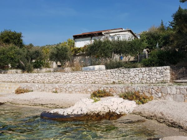 House for renovation on the seafront in Croatia for sale.
