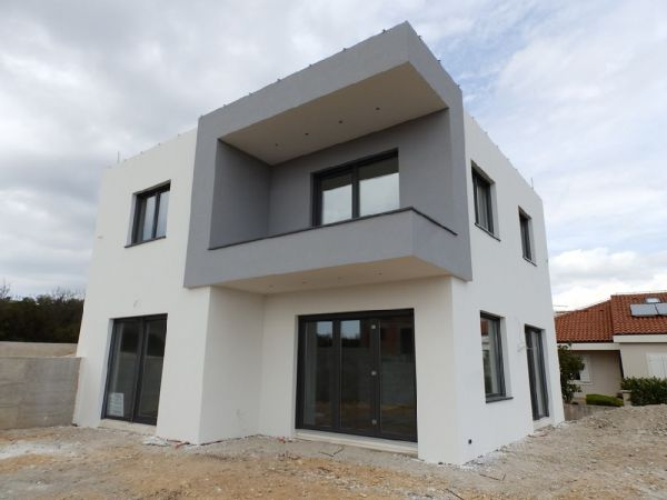 Garage and entrance of Villa H1102 which is for sale near Vodice in Croatia.