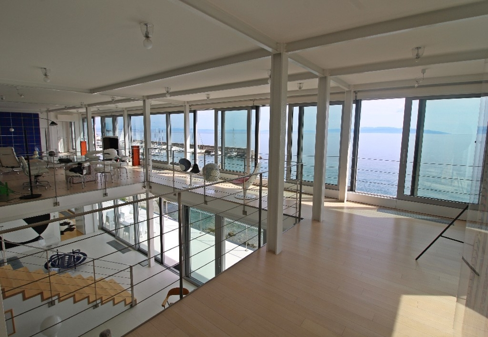 Interior overlooking the sea and swimming pool.