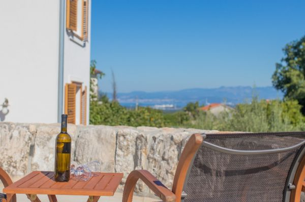 Country houses with pool and sea views for sale on the island of Krk in Croatia.
