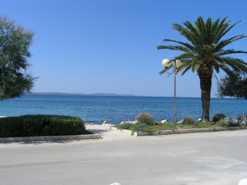 View from the house to the street and the sea directly from the property H1275 - Buy a house in Croatia.