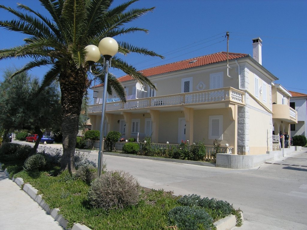 View from the pedestrian path to the street and the house front directly on the sea - Buy a house in Croatia.