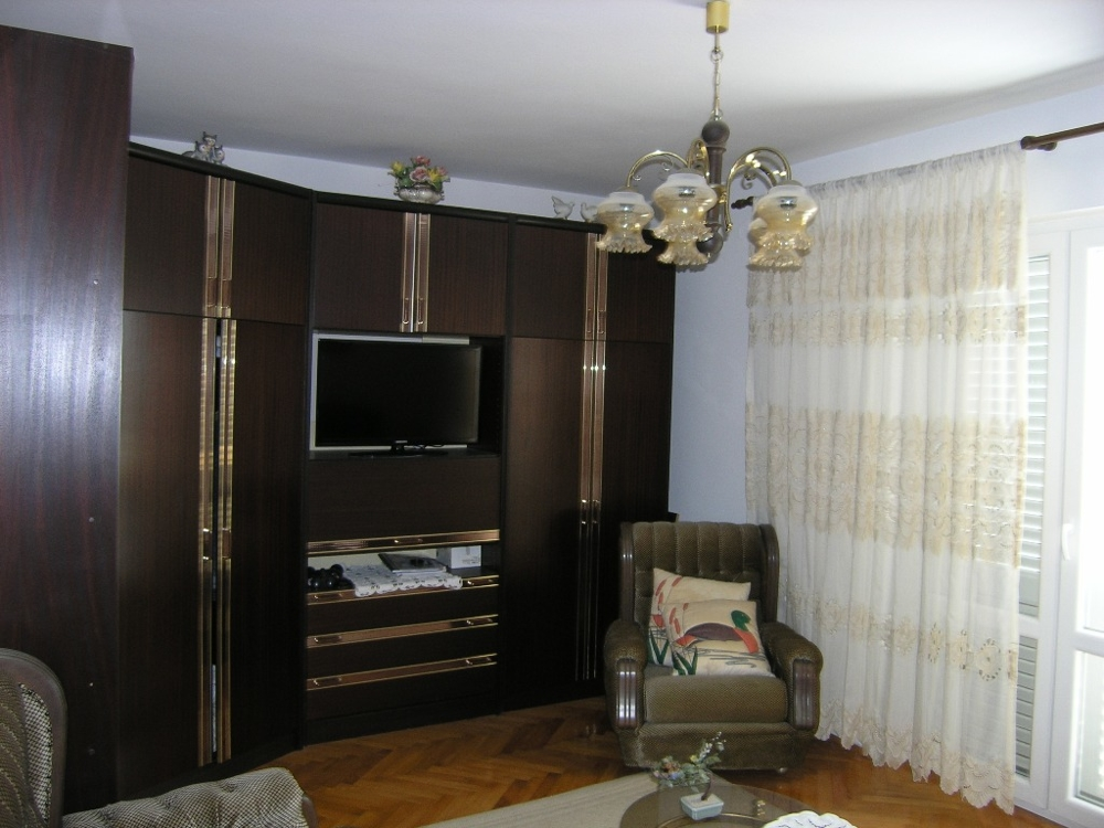 Living room with a wall unit and exit to the balcony in the Zadar region.