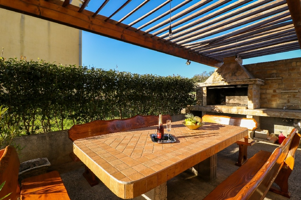 Outdoor grill with seating area