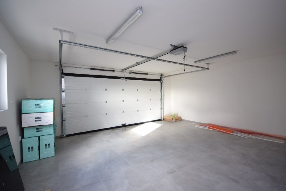 Spacious garage for 2 cars.