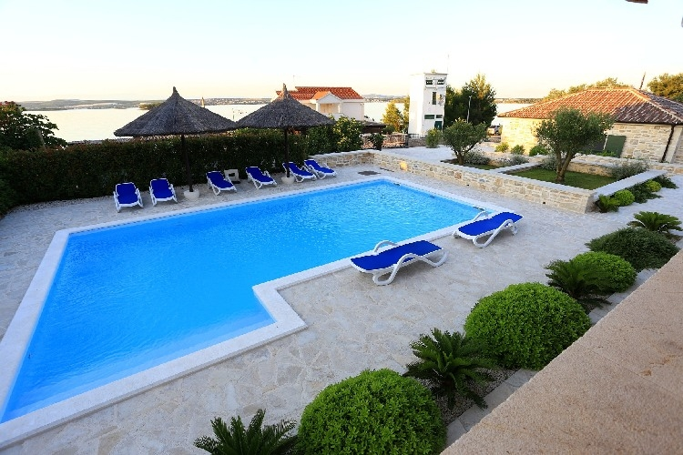 Swimming pool with sea view - real estate in Croatia.
