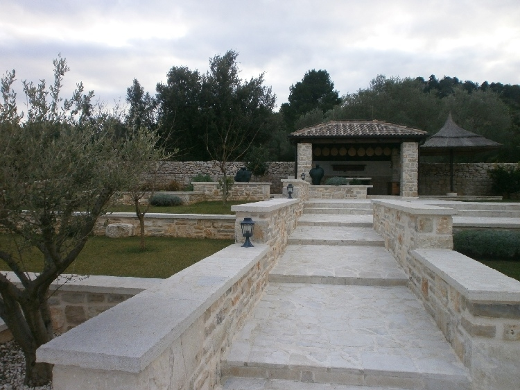 View of the Mediterranean outdoor area with barbecue grill.