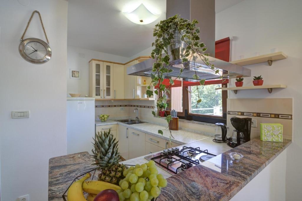 A kitchen of the property with window and sideboard