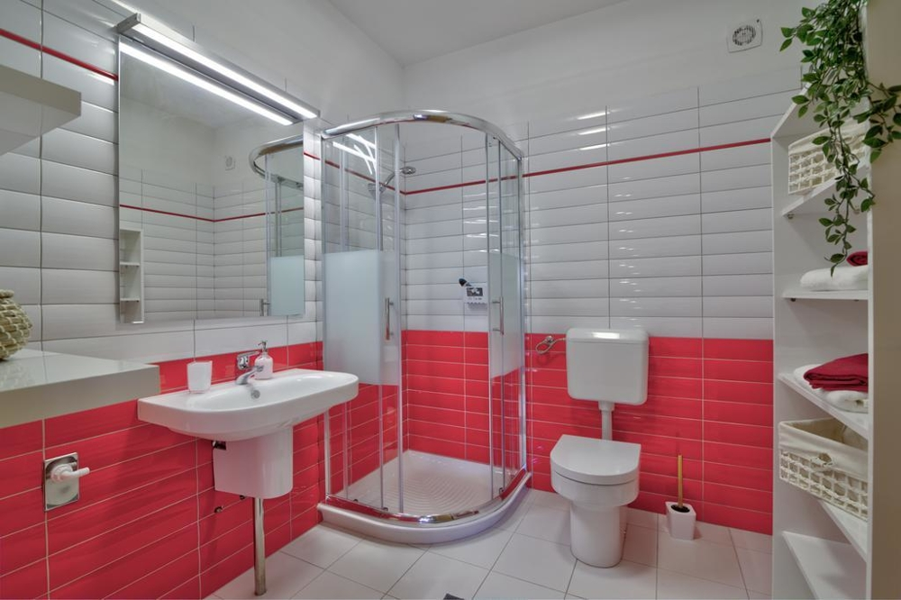 Another bathroom with shower and toilet
