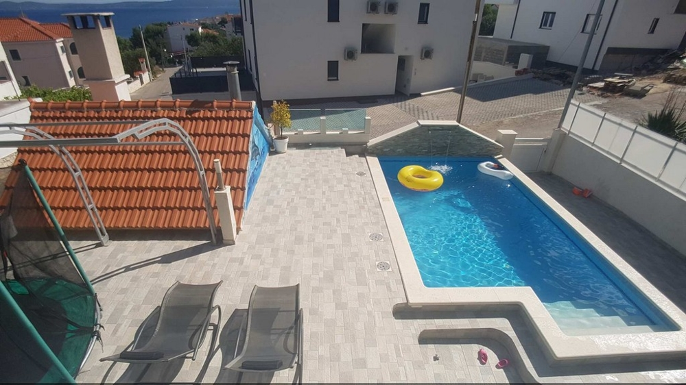 View from a balcony of the terrace and the swimming pool