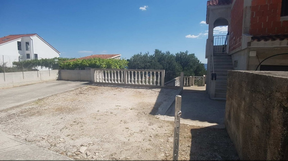 View of the parking spaces of the property in the Trogir region
