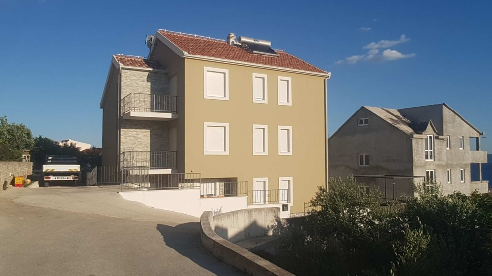 View from the street of the house with the balconies in the Trogir region - panorama scouting.