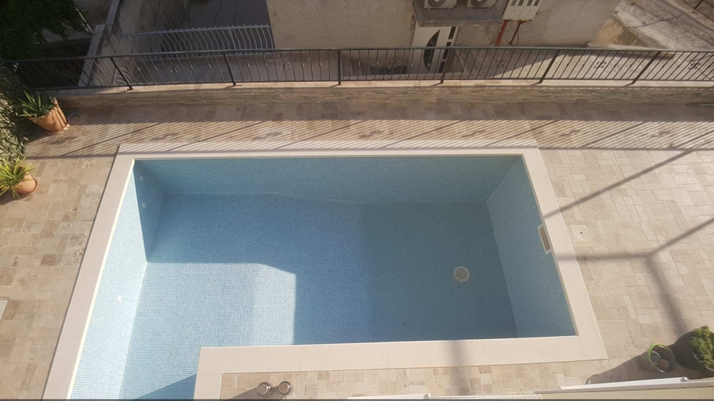 Top view of the swimming pool with the terrace of property H1476 in Dalmatia.