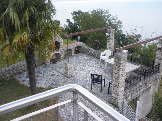 View from the balcony of the barbecue area with dining area in the Opatija region.