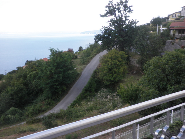 View from the terrace of the access road to the property and the sea in the Kvarner Bay.
