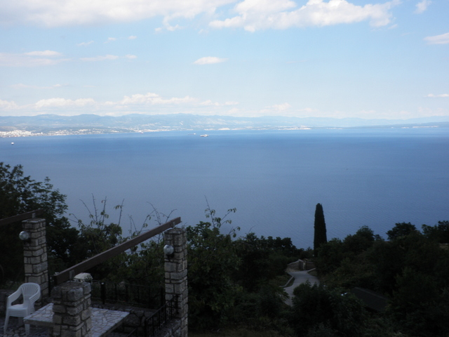 View from the property with a view of the barbecue area and the surrounding area with the sea in the Opatija region.