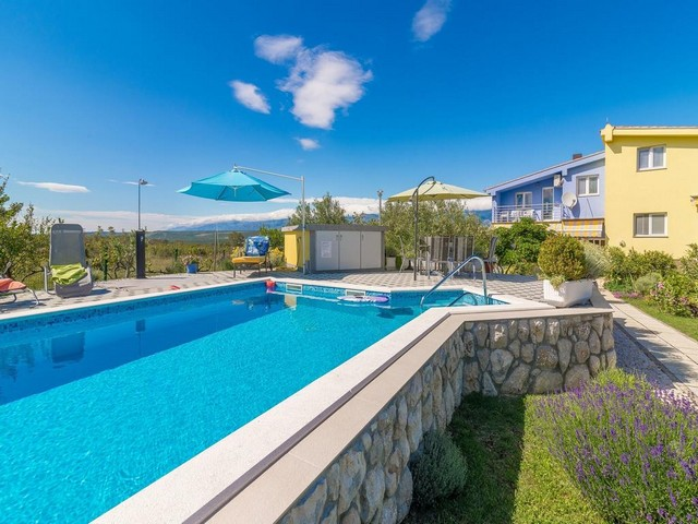 View of the swimming pool and the house with garden in the Zadar region.