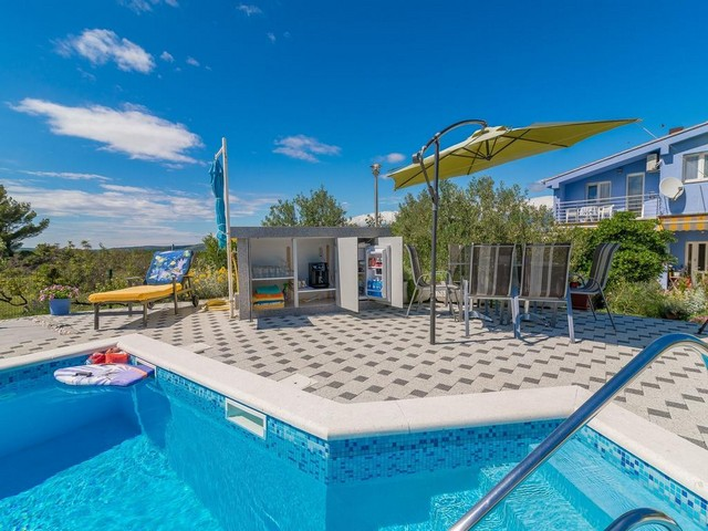 View of the bar by the swimming pool with a parasol in North Dalmatia.
