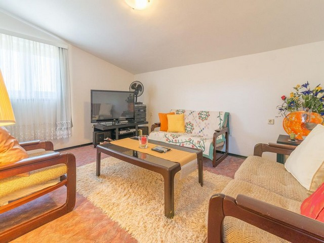 View of the living room with couch and table in the Zadar region.