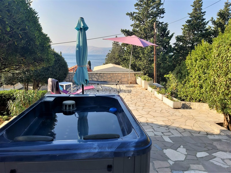 View of the terrace with whirlpool and a view of the sea - buy a house in Croatia.