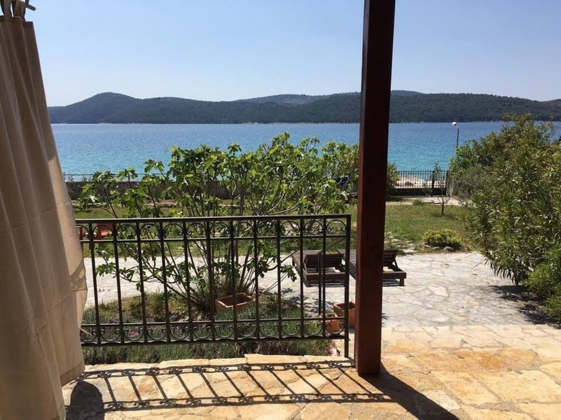 View from the house entrance to the property and the sea - Buy an apartment house in Croatia.